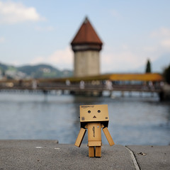 a gentleman in lucerne (Toni_V) Tags: bridge tower square schweiz switzerland amazon europe dof bokeh luzern dieter lucerne wasserturm 100904 2010 chapelbridge kapellbrcke d300 danbo 5018 revoltech capturenx toniv danboard dsc3972