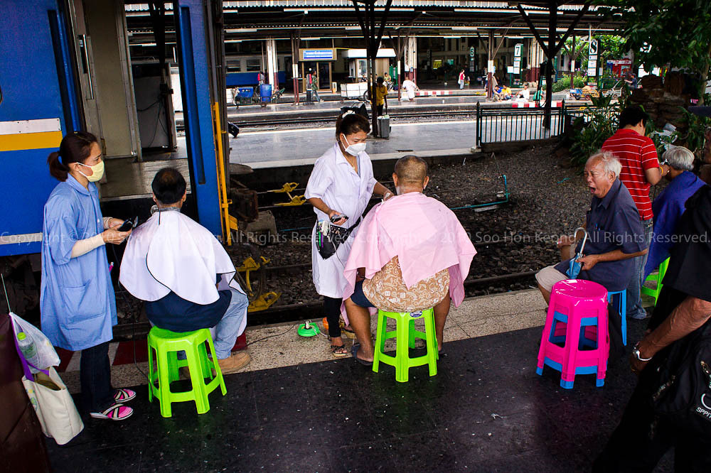 Barber beside Train Track @ Hua Lamphong, Bangkok, Thailand