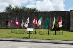 Nine flags over Goliad (stevesheriw) Tags: texas goliad goliadcounty presidio nationalhistoriclandmark nationalregisterofhistoricplaces 67000024 presidionuestrasenoradeloretodelabahia labahia 1749 spanishcolonial architecture fort flag flags