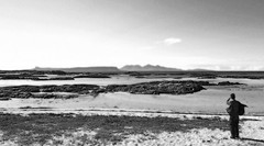 the gentle man and the sea (bobbat) Tags: ocean light sea blackandwhite bw man beach islands scotland sand friend rocks glow view grain brightlight gentleman gentle vast rhum arisaig eigg ebbing ebbed gorrrrgeousscotland