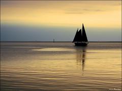 Ocracoke Sailboat Sunset (Bruce Wise) Tags: sunset usa water colors photoshop canon island coast nc flickr adobe wise tranquil hdr obx ocracoke 2010 cs4 pamlicosound photomatix tonemapped