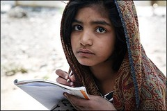 A girl studying in Pakistan's flooded area.