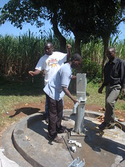Ebumamu Primary School rehabilitated well-attachment of water tank during pump installation.