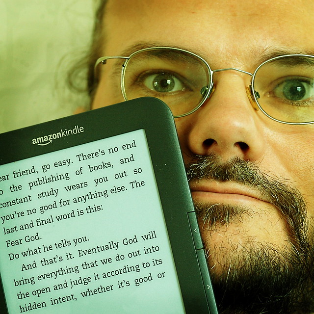 Wulf posing with his new Amazon Kindle. The text on the screen is a quote from Ecclesiastes 12:12
