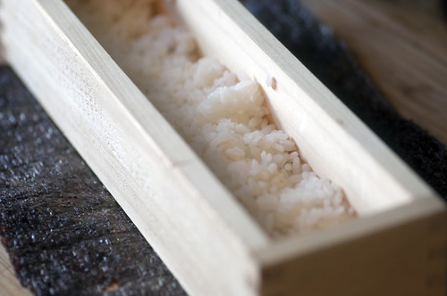 Sticky rice in sushi press