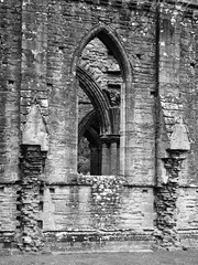Nested arches (tom.wright) Tags: uk greatbritain blackandwhite bw white black window monochrome abbey vertical stone wales grey mono arch nest gray ruin arches progression nested tinternabbey tintern canonefs1022mmf3545usm tomwright copyright2010