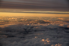 going home, part x (Cybergabi) Tags: travel blue sunset sky white clouds golden inflight pretty air fluffy flyby 5f