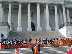 Anti-Torture Protest at the US Capitol Steps (Shrieking Tree) Tags: usa america army cross cia military protest photojournalism christian demonstration torture humanrights vigil protesters guantanamo abughraib abuse jumpsuit kandahar johnyoo photojournalist gitmo degrading inhumane detainees bagram boilersuits d80 protectthehuman waterboarding