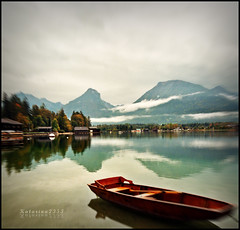 Expecting rain (Katarina 2353) Tags: landscape nature autumn austria wolfgangsee lake wolfgang water reflection boat fog mist trees wood mountain sky clouds alps alpes backgrounds colors wallpapers desktop osterreich salzkammergut berg stwolfgang austriche upperaustria abersee mywinners near badischl mygearandmepremium mygearandmebronze mygearandmesilver mygearandmegold mygearandmeplatinum gettylicence sterreich tjkp priroda katarina2353 katarinastefanovic photography film flickr image nikon pejza paisaje paysage