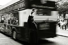 Melting (Che-burashka) Tags: street people blackandwhite bw man motion black bus london hat reflections movement places bn retro suite oldtimes slowshutterspeed londonist ef28mm canonef28mmf18usm