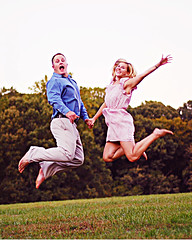 (kismekate) Tags: woman man love field fun engagement jumping kissing funny couple legs marriage ring midair actions engagementshoot nikond40 flickrchallengegroup flickrchallengewinner