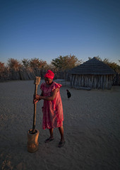 Ovambo tribe woman in Ruacana area - Namibia (Eric Lafforgue) Tags: africa sunset food woman work african afrika namibia 275 namibian pilon namibie namibe ruacana namibi namiibia     namibya namibio