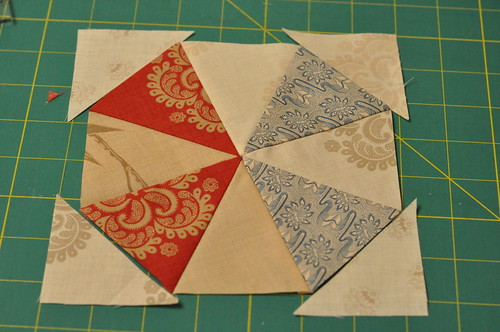 Sew triangles to the corners to complete the 12-piece kaleidoscope block