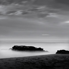 Twilight (Gerald Verdon) Tags: ocean leica longexposure sea sky bw copyright blur beach portugal water rock clouds square haze europe gallery waves mood fav50 horizon voigtlander rangefinder fav20 nb m8 fav30 guincho legacy cascais nokton verdon carr waterscape 500x500 bsquare fav10 nd8 neutraldensity fav40 fav60 nokton50 fav70 flickraward thechallengefactory fotocompetitionbronze redmatrix daarklands flickraward5 heavenlyexcellence allrightsreservedgraldverdon wwwambiluxorg
