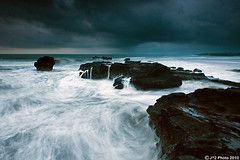 Stormy Sea (J.^2) Tags: sunset sky bali beach rain rock dark indonesia flow force power cloudy no wave stormy swirl splash gnd mengening