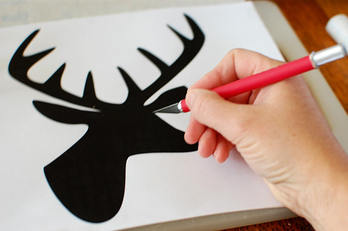 Cutting reindeer shape with an exacto knife