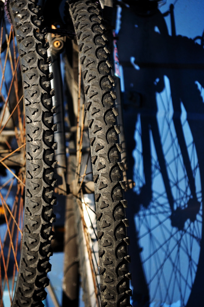 Bicycle wheels and shadows.