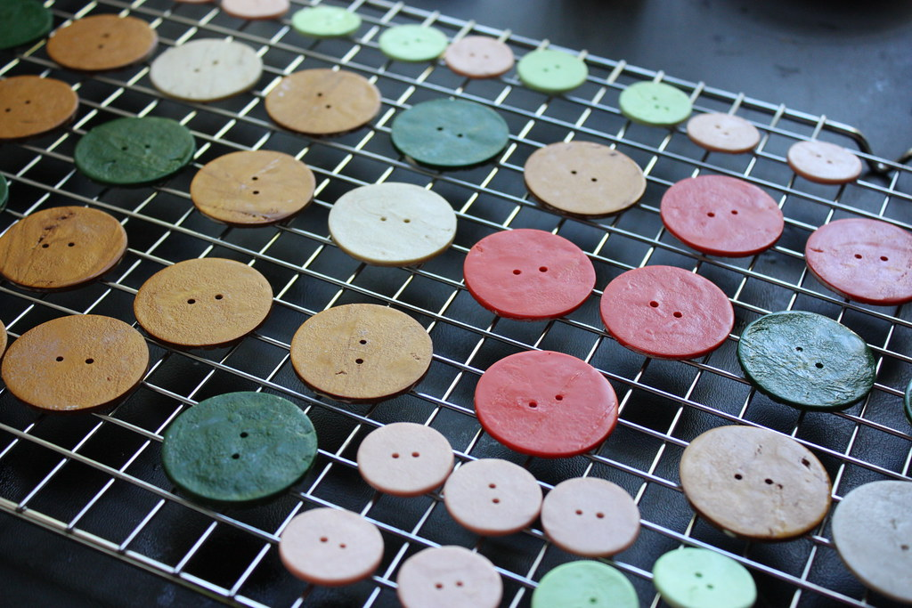 Last batch of buttons being glazed