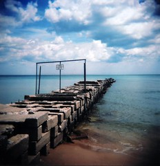 Away (.michael.newman.) Tags: park blue summer lake 120 beach nature water sign wisconsin clouds fence mediumformat square holga lomo sand fuji iso400 michigan jetty horizon atwater keepoff parkclosed