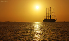 Long Journey (Ben Heine) Tags: ocean voyage trip travel cruise sunset sea summer wallpaper hot reflection art love silhouette composition de relax fire photography gold freedom golden evening solar holidays energy warm heaven waves ship quality horizon transport illumination poetic sharp greece shore enjoy tropical romantic gleam imaging unreal t copyrights volcanicisland grce zon brightness cyclades mykonos feu vibration waterscape noces rverie ignite clart croisire sailingboat chaleur aegeansea theartistery longjourney naviguer benheine coucher soleil flickrunited enflame samsungnx10 benheinecom geologicalcaldera bateauvoil