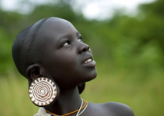 Surma Suri girl with big earrings - Ethiopia (Eric Lafforgue) Tags: africa portrait girl artistic earring culture tribal piercing ornament tribes earrings bodypainting tradition ethiopia tribe ethnic rite fille surma tribo adornment afrique pigments ethnology tribu omo
