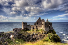 Dunluce Castle (Mick h 51) Tags: county blue ireland vacation sky holiday castle history rock movie coast ruin sigma medieval caves northernireland nordic jackiechan vikings 1020 ledzeppelin giantscauseway basalt bushmills portrush antrim skerries dunluce dunlucecastle causewaycoast housesoftheholy