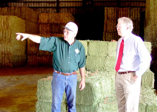 Farmer  David Fink (left), owner of Heidel Hollow Farms shows State Director Tom Williams, how Rural Energy for America Funding will help reduce his farm's energy costs.