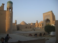 Evening in Khiva (magellano) Tags: light architecture evening twilight madrasah uzbekistan madrassa architettura luce sera khiva ichonqala crepuscolo madrasa medressa supershot xiva  itchankala alloqulikhan muhammadaminkhan tashaulipalace toshovlipalace