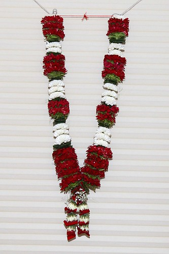 Its a long tradition in India where flower garlands has an important role in