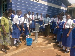 Matende sec school - Head mistress pumping water