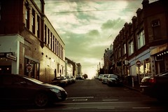 landscape #2, greeves st (mugley) Tags: road sunset sky cars film clouds 35mm buildings xpro crossprocessed glare shadows minolta suburban fitzroy australia melbourne slide victoria aerial scan powerlines wires epson pointandshoot suburbs parked konica 135 agfa antenna urbanlandscape c41 precisa agfactprecisa100 v700 colourshift ctprecisa100 greevesst lomophobia freedomzoom160 rivazoom160 minoltafreedomzoom160