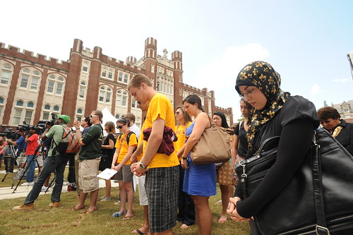 Students in Prayer Before Campus Announcement
