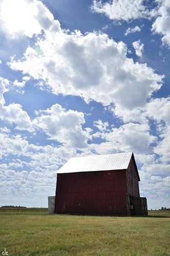 big sky and red barn