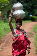 Sur la route (hubertguyon) Tags: road woman india village femme tribal porter orissa carry chemin inde tribu mywinners dhuruba earthasia