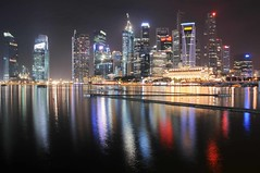 Marina Bay and Central Business District - long exposure (Mo Baig) Tags: longexposure travel copyright reflection architecture night buildings reflections lights lowlight nikon singapore asia cityscape view sigma views allrightsreserved marinabay d90 greatphotographers platinumphoto nikond90 earthasia sigma18200mmoshsm nikonflickraward worldwidetravelogue mobaig flickrtravelaward