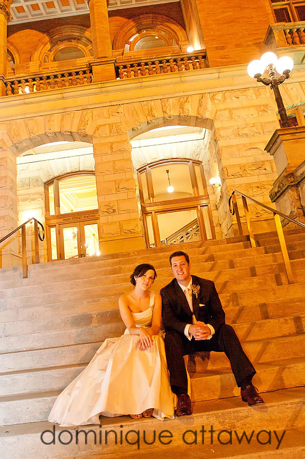 newlyweds sitting on the steps of Main street station in Richmond