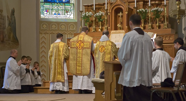 Father David Kemna, FSSP, at Saint Francis of Assisi Catholic Church, in Portage des Sioux, Missouri, USA - Prayers at the foot of the altar