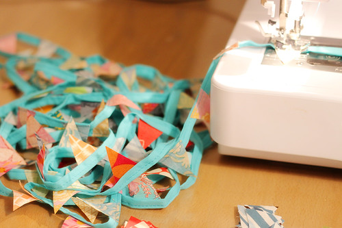 Lines of bunting coming out the back of the sewing machine