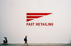 speed shopping (ho_hokus) Tags: nyc newyorkcity newyork walking 5thavenue pedestrian 35mmfilm fifthavenue afc compactcamera fujicolor100 minoltaafc fastretailing ny2010