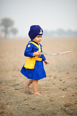 Swashbuckler (gurbir singh brar) Tags: november blue boy nikon sword warrior warriors turban sikh punjab nikkor bana 2010 singh khalsa twoyearold nihang nihangs mastuanasahib bhujangi dumala gurbirsinghbrar nikond3s  razasingh