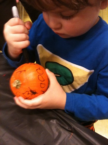 decorating a pumpkin