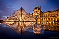 bijou classique (helen sotiriadis) Tags: blue orange paris france reflection water yellow museum architecture canon gold lights twilight pyramid louvre bluehour canonefs1022mmf3545usm canoneos40d updatecollection