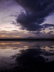 caught between two clouds (ssj_george) Tags: blue sunset cloud mountain lake reflection nature water vertical lens landscape lumix sundown horizon salt cyprus panasonic saltlake pancake 20mm dmc skala larnaca larnaka kypros f17 gf1 stavrovouni  photographyblog kipros  georgestavrinos   micro43 microfourthirds ssjgeorge  sonyphotochallenge