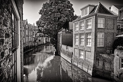 Deep Vision (Alfred Grupstra) Tags: canal architecture house urbanscene river europe history buildingexterior bridgemanmadestructure old street city water builtstructure cityscape veniceitaly famousplace outdoors blackandwhite dordrecht nl