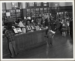 School children at EPFL branch no. 12, ca. 1940 (Enoch Pratt Free Library) Tags: old city people urban blackandwhite bw black history kids children photos interior library maryland books scene baltimore photograph africanamericans africanamerican local librarians bookshelves pratt enochprattfreelibrary mdch prattlibrary