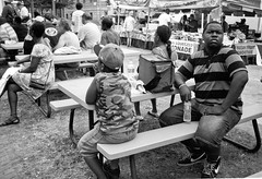 frown (patrickjoust) Tags: street city trip boy people urban bw usa white man black film blanco home analog america 35mm bench lens ed person us kid und md nikon focus glare child y mechanical kodak tmax scanner united young patrick maryland olympus baltimore v developer 100 40 states manual 40mm frown joust 35 weiss developed zuiko f28 2010 develop estados artscape blancetnoir unidos autaut negroschwarz patrickjoust