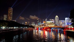 Singapore by Night (croquembouche76) Tags: city bridge light sky urban color water colors night clouds river landscape asian lights singapore colorful asia skyscrapers shot stadium 5 sony iso 1600 handheld singapour asie nuages paysage nuit beams ville lumires urbain nex gratteciel nohdr nex5