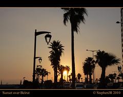 Beirut Corniche Sunset (StephenJR) Tags: sunset sky lebanon orange sun yellow dark shadows corniche boardwalk posts beirut 2010 pub1 lght raouche