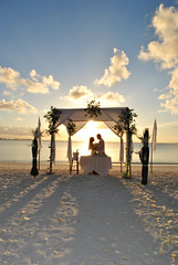 A successful marriage requires falling in love many times, always with the same person. (Scinern) Tags: blue wedding sunset sea sky hot flower sexy love beach water rose clouds coconut flag husband shangrila hut wife pavilion maldives addu c9n