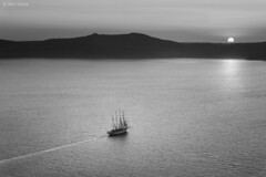 Evening Traveller (Ben Heine) Tags: ocean voyage camera light sunset wallpaper blackandwhite mist inspiration art nature fog sailboat speed landscape island photography freedom seaside movement focus holidays energy rocks track waves nightshot pov earth space marin horizon trace peaceful atmosphere romance sharp oxygen santorini greece libert romantic zodiac sailor bateau copyrights paysage brouillard dynamism connection thira voilier ecosystem fira vibration vitesse waterscape sailingboat luminosity vrijheid highquality theartistery paisible crique creativecomposition benheine limited flickrunited farawayhills editions samsungnx10 benheinecom eveningtraveller